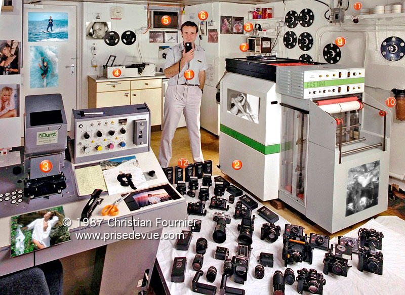 90a592104f2b 1 - Chief photographer Christian Fournier holding Minolta Flashmeter 2 -  Paper processor Wenko. The exposed paper is on rolls and loaded in the dark  at the ...